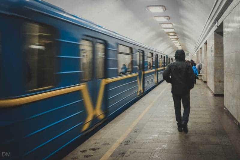 Man on the platform of Arsenalna Metro Station in Kiev, Ukraine